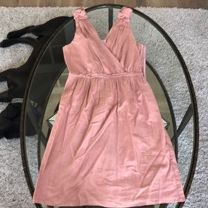 A pink dress it has rose at the top of the straps